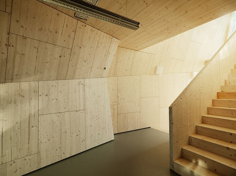Spruce office building interior with wooden staircase