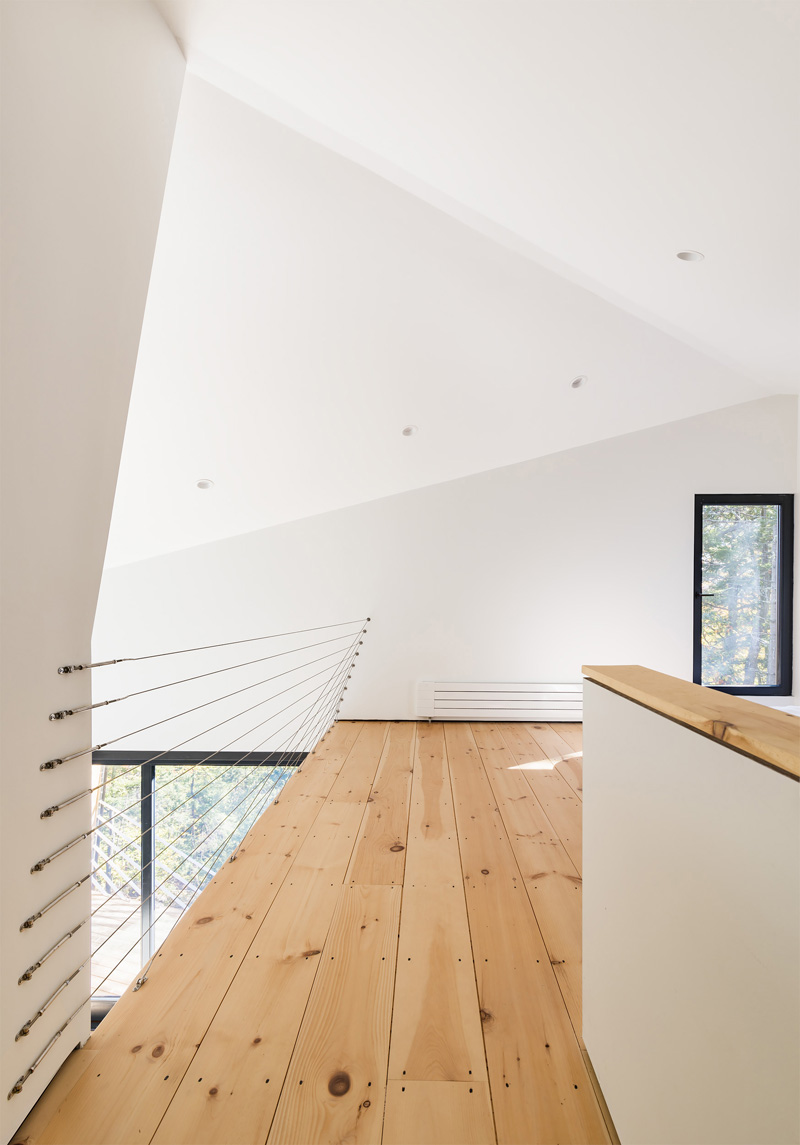 Double height space in wood and white plaster