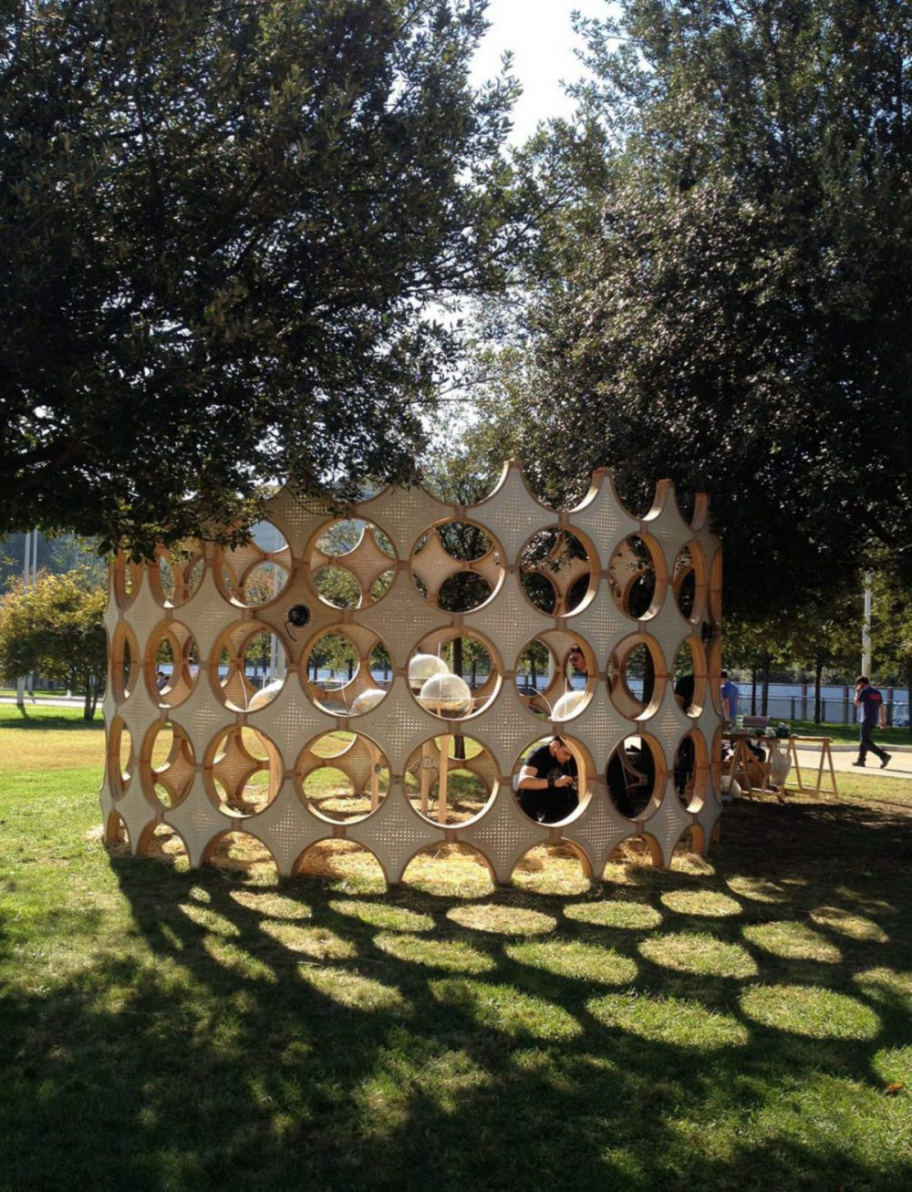 Wooden pavilion with geometric shapes