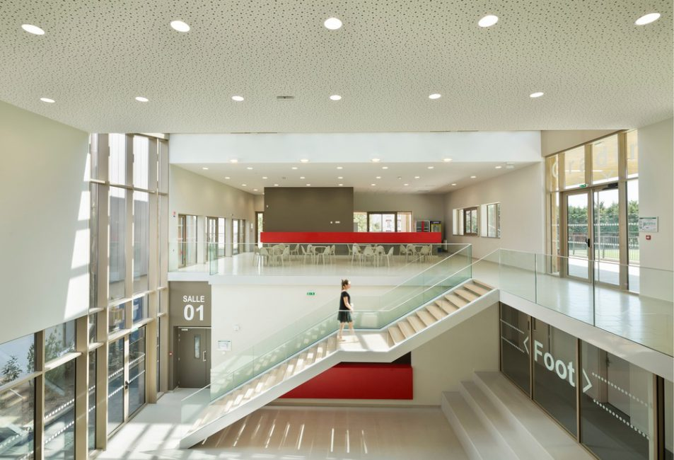 Double-height minimal sports center interior