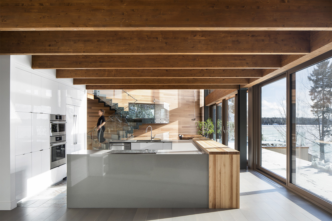 Island kitchen and bay window on nature