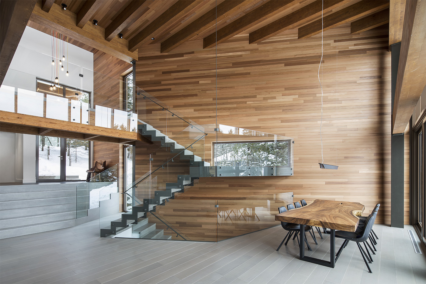 Internal wooden hut with glass and metal staircase