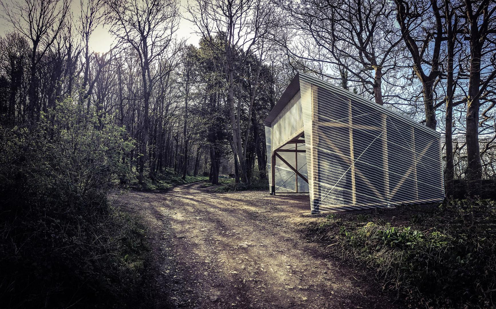 Laboratory among the trees with wooden structure and walls in corrugated steel