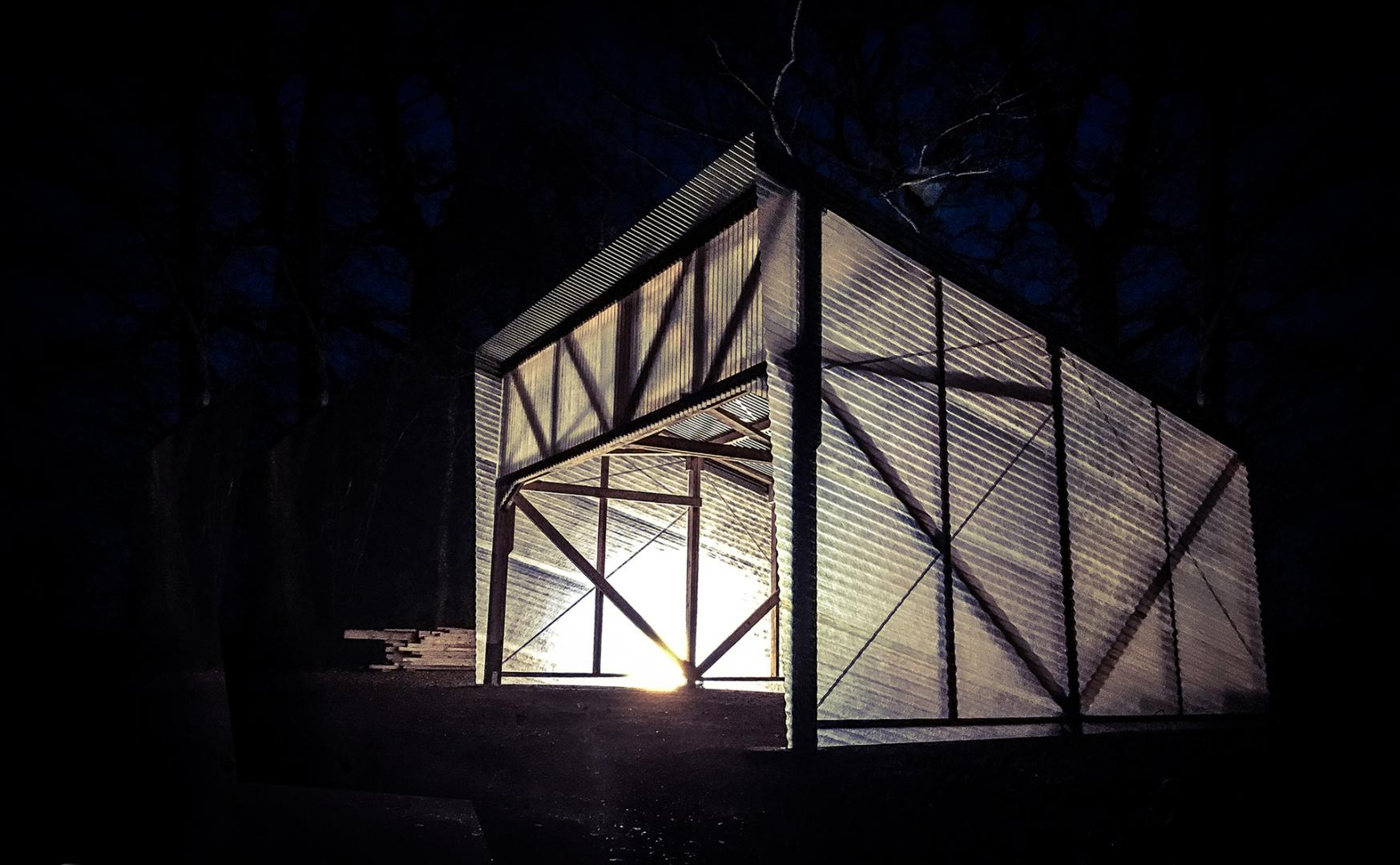 Laboratory among the trees with wooden structure and transparent walls lighting night fiberglass corrugated steel