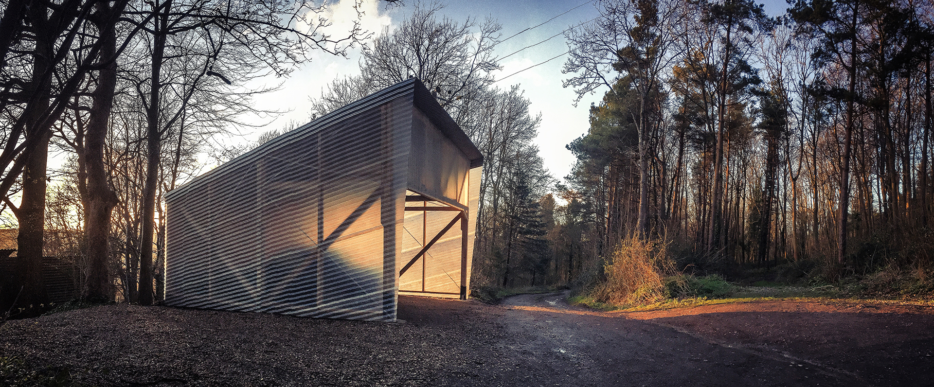 Laboratory among the trees with wooden structure and transparent walls fiberglass corrugated steel