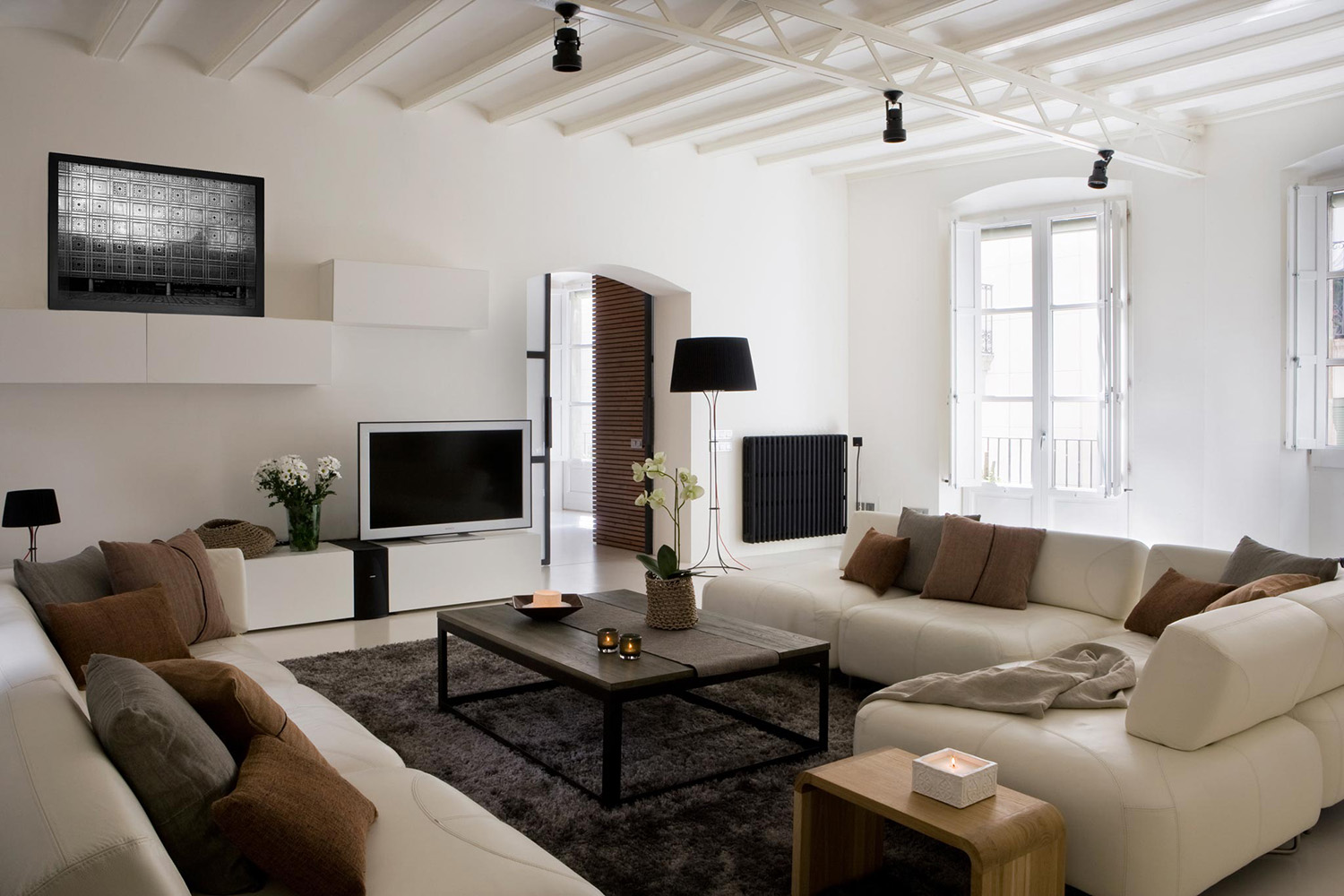 The light-colored living area and the completely white ceiling