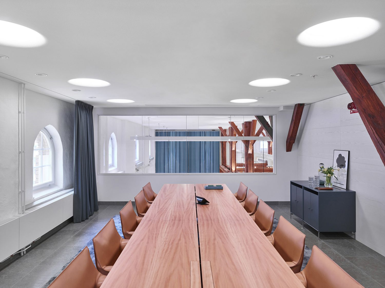 Meeting room with salmon colored tables and chairs