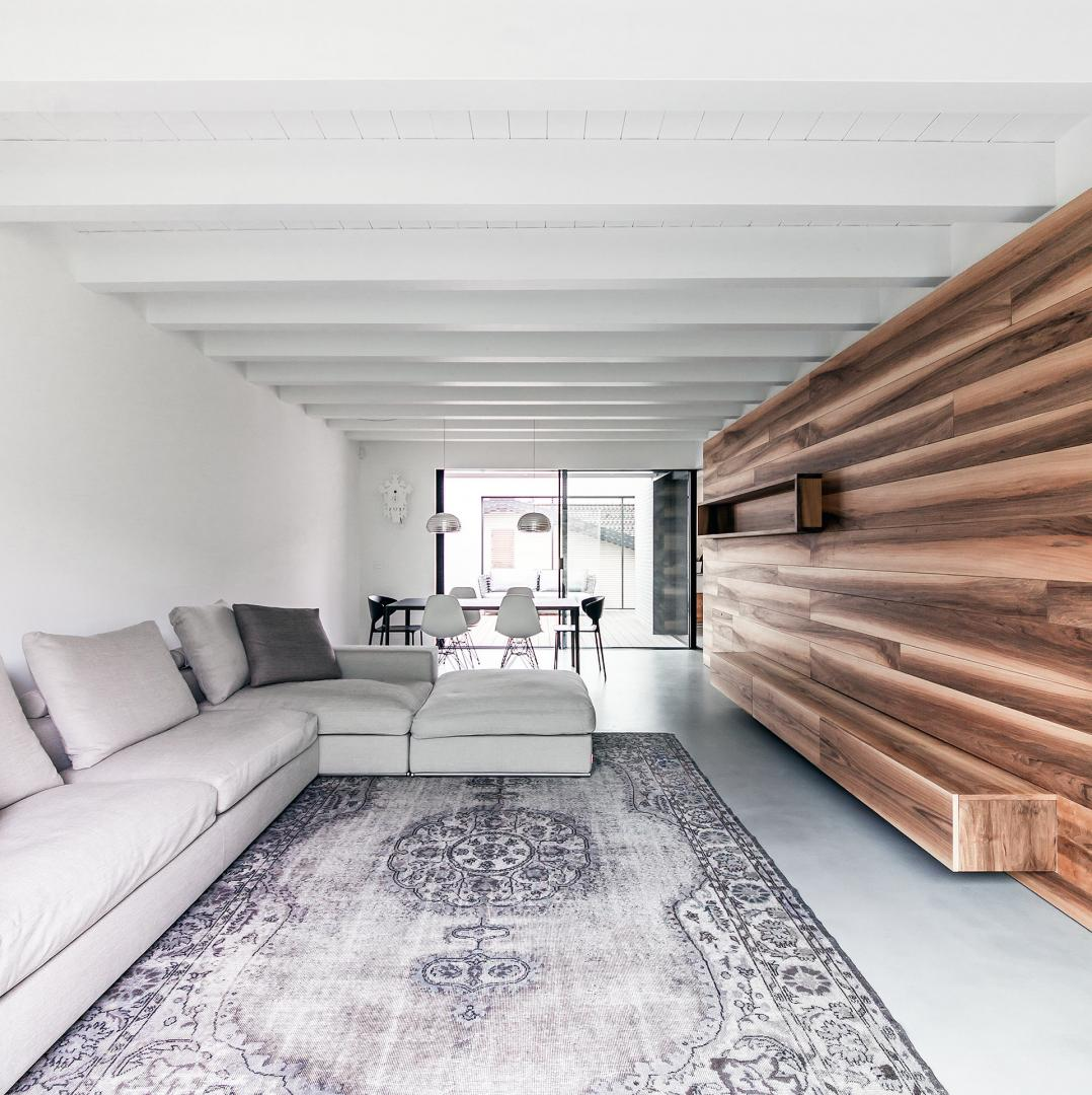 Living room with wooden wall