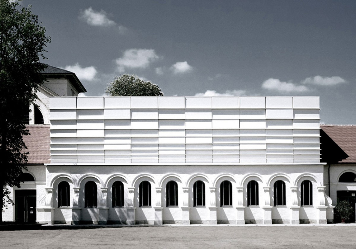 Facade Opera by Erl covered with Equitone Natura fiber cement panels
