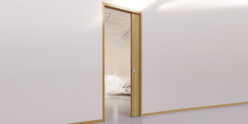 Sliding wall and hinged doors with Eclisse wall flush jambs