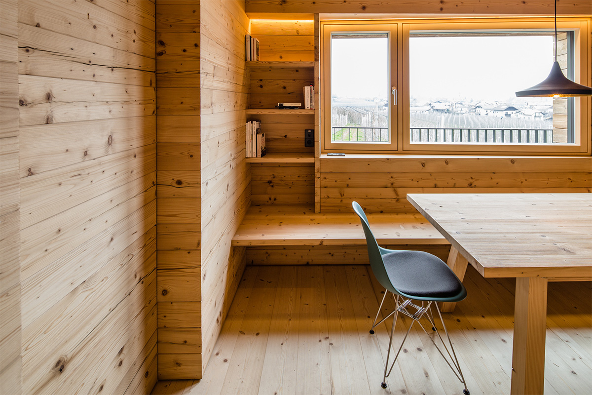 Room completely covered in wood and with Hausplus wooden doors and windows