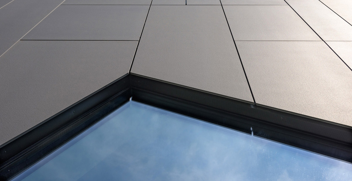 Sintered stone slabs for ventilated façades