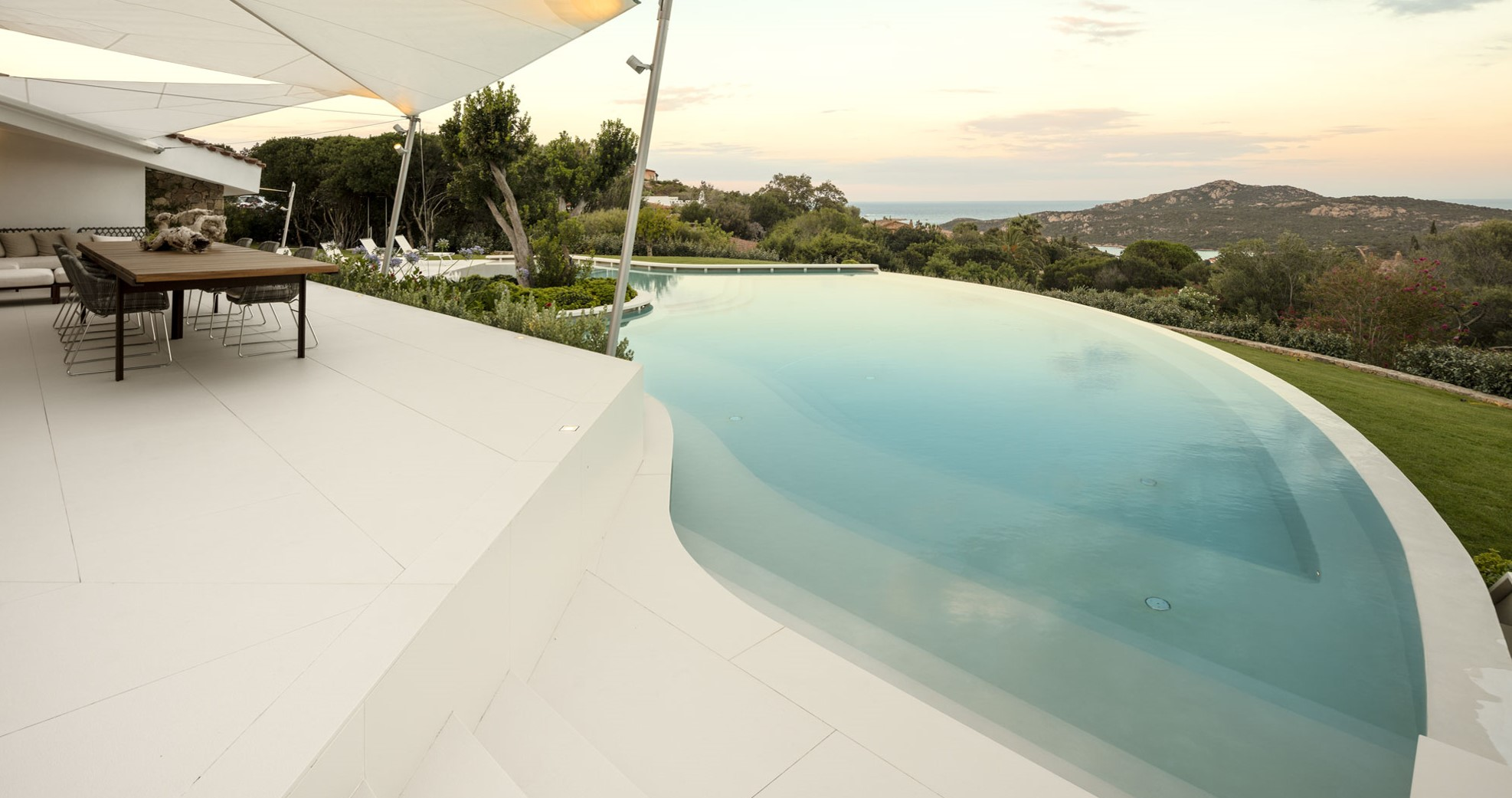 Sintered stone slabs for swimming pools