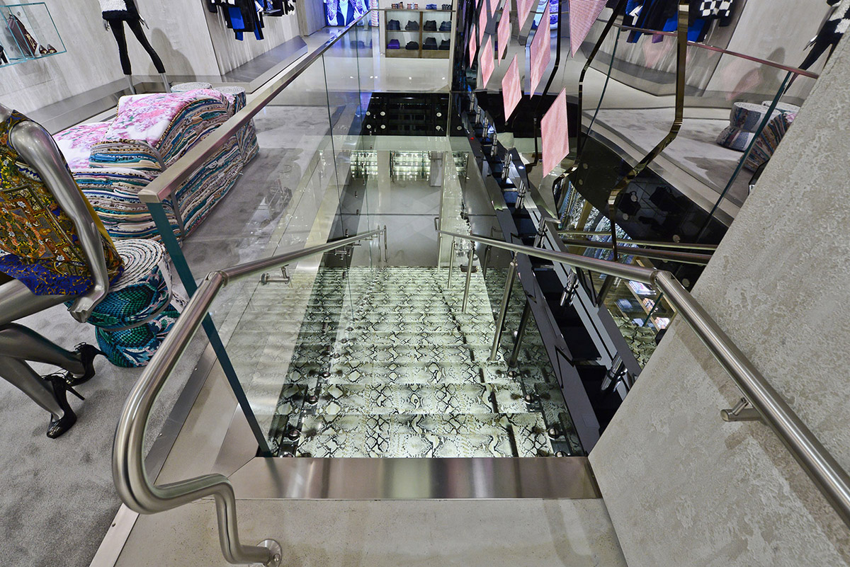 Glass staircase with python inserts